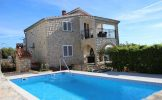 Family apartment with the pool in Rogac